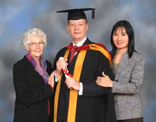 Victor with his mother and his partner receiving his LLM