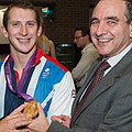 Julius Weinberg posing with Ed McKeever and his gold medal