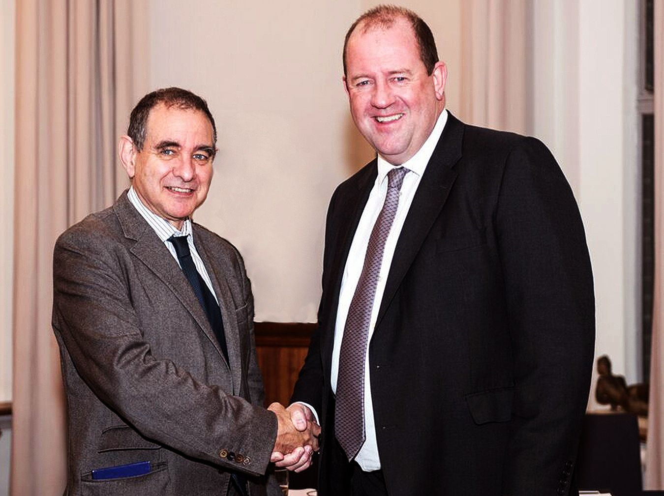 Kingston University Vice-Chancellor Professor Julius Weinberg shaking hands with Amey Plc Chief Executive Mell Ewell.