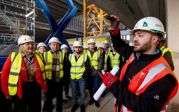 A landmark building in the making – Kingston Mayor joins local residents to see how Kingston University's Town House is taking shape