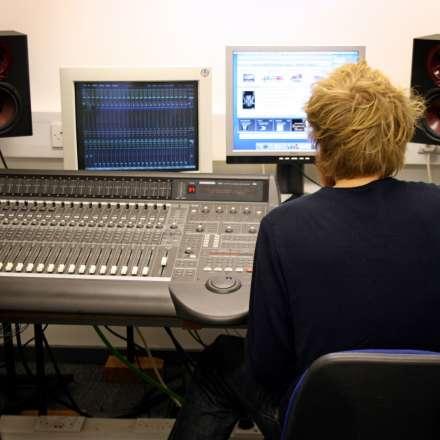 Student doing video editing machines