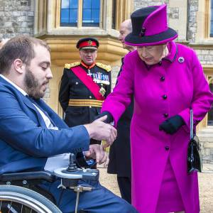Queen presents adapted Motability vehicle to Kingston University disability adviser at Windsor Castle