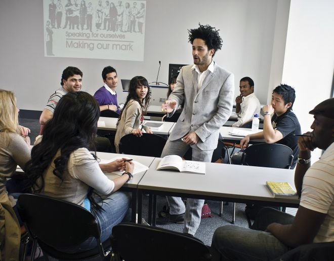 Students discussing their studies at a seminar at Penrhyn Road campus