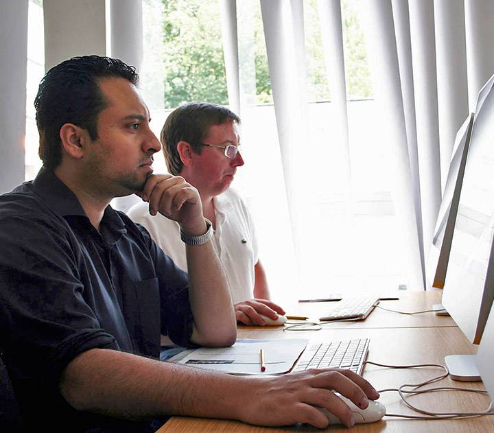 Postgraduate students in computer suite