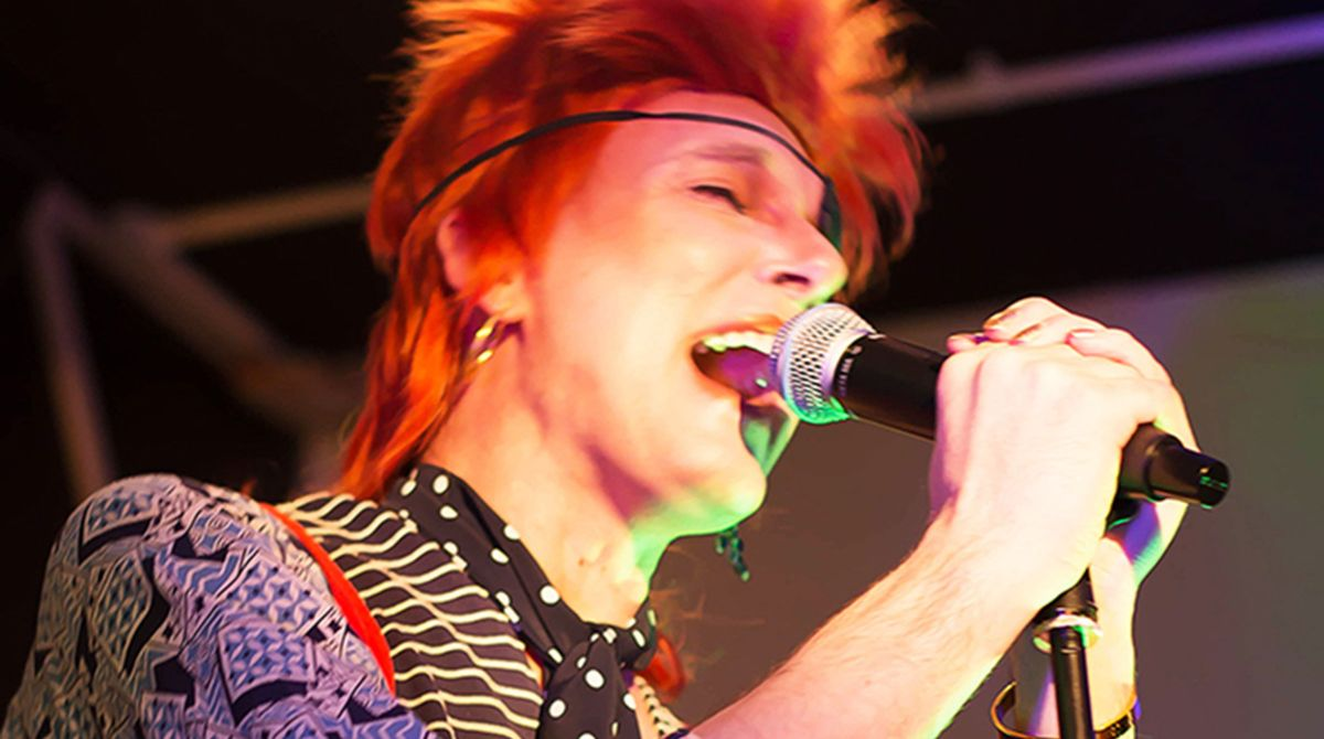 Researcher Professor Will Brooker raises the roof as David Bowie at Kingston University Ziggy Stardust tribute concert