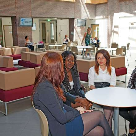 Students catching up in the Business School atrium