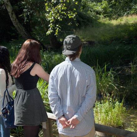 Students by the pond on Kingston Hill campus