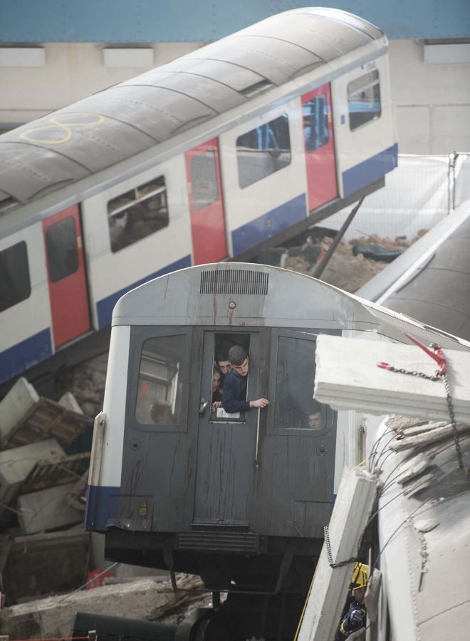 Volunteer casualties wait to be rescued from one of the train carriages in the staged incident. Image: REX/Shutterstock