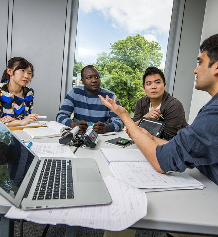 Postgraduate students in group study room