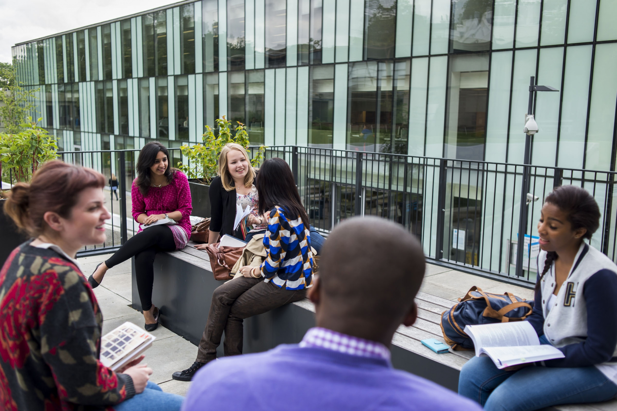 Students using one of the communal areas at Kingston Business School