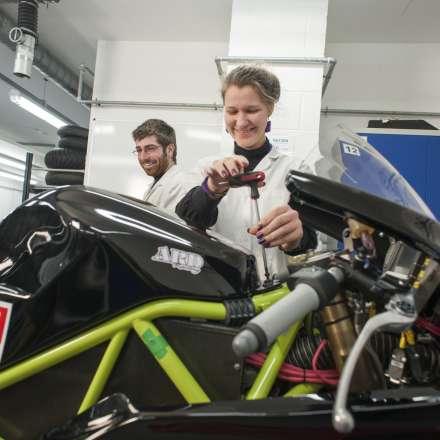 Motorsport engineering students at work
