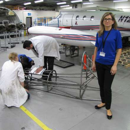 Students at work in the Lear Jet hangar