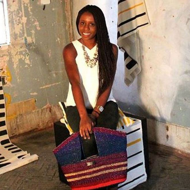Akosua Afriyie-Kumi with her fashion handbags