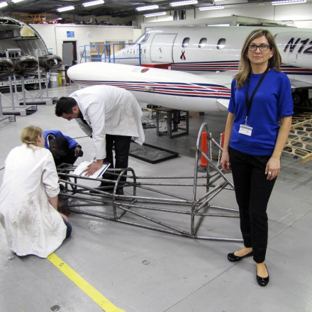 Aeronautic students working with the Kingston Lear Jet