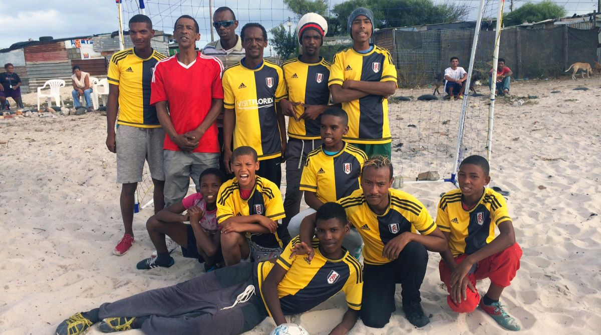 Kingston University geography students kit out youngsters in Fulham Football Club strip during South Africa field trip