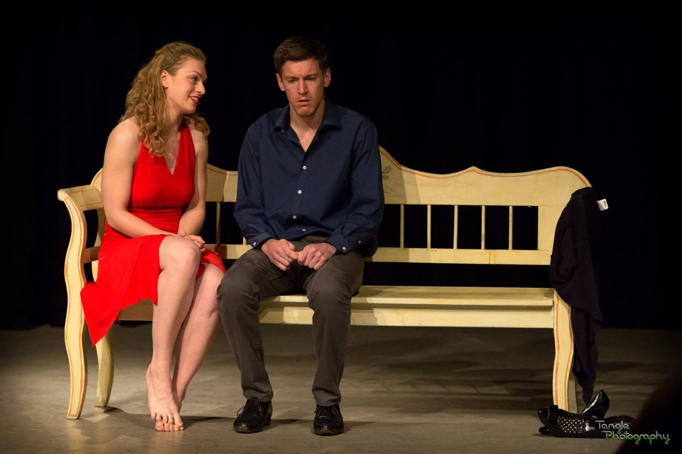 The actors on stage performing The Edge