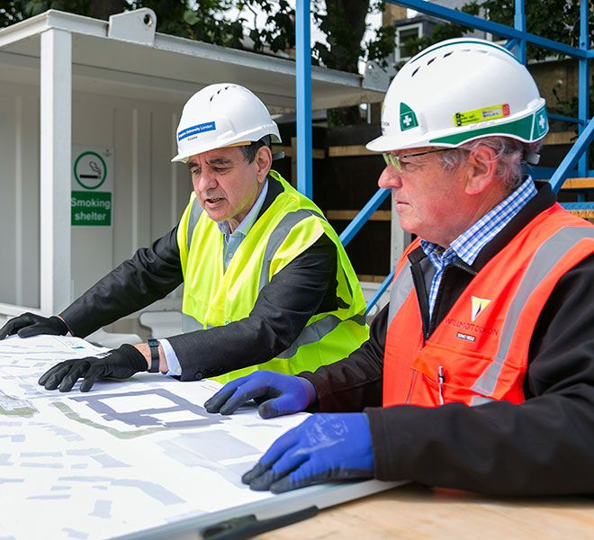 Professor Julius Weinberg and Willmott Dixon Manager Paul Brewer looking at plans for the new Town House building