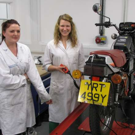 Students working on motorbike