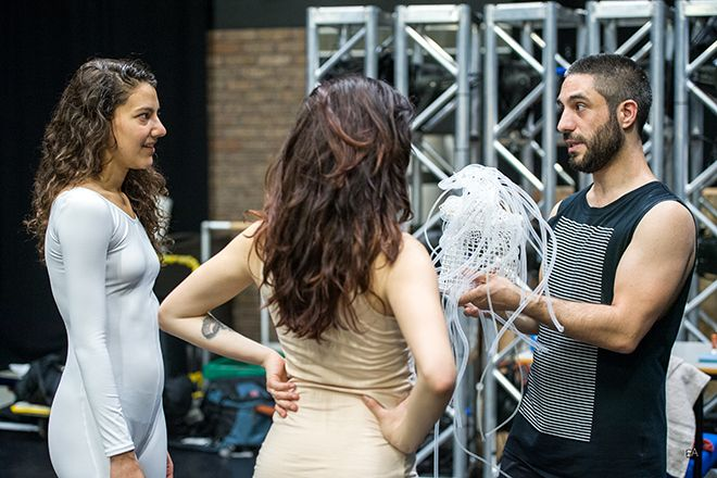 Nigel Guérin-Garnett instructs dancers ahead of his performance at the MA Fashion Show.