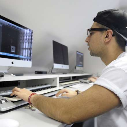 A student using one of our music technology suites