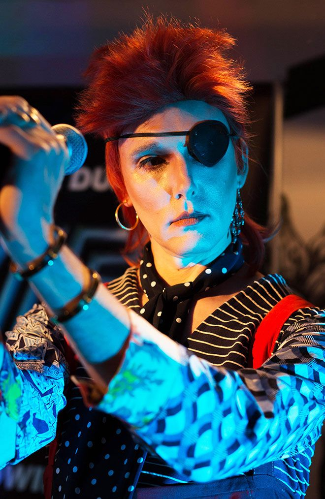 Professor Will Brooker dressed as Ziggy Stardust singing with The Thin White Duke band