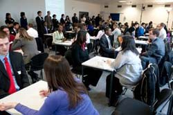 Students practising interview skills at a 'speed interviewing' event