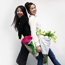 Daisy Wang, left, and Winnie Lao are the brains behind the reusable Pozzy flower carrier.