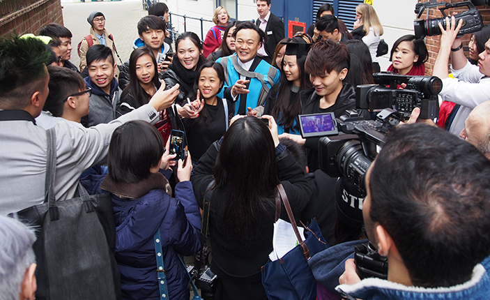 Eason Chan is swamped by fans outside the Rose Theatre after collecting his honorary degree.