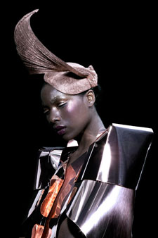 Sweeping avante garde head pieces completed Sadie Clayton's Grace Jones-style silhouettes.