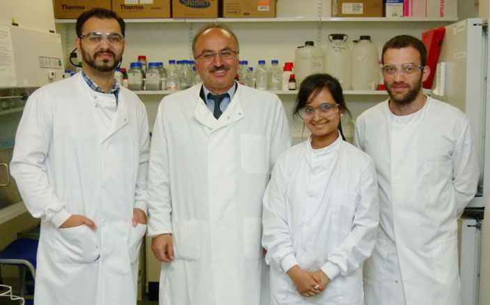 Professor Helmout Modjtahedi, second left, with PhD students, from left, Said Khelwatty, Soozana Puvanenthiran and Nikolaos Ioannou in the Kingston University laboratories.