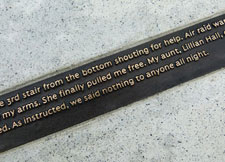 Small bronze plaques on the memorial contain testimonials from survivors, emergency service personnel and relatives.