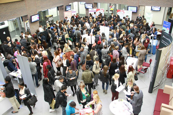 Careers event with retail employers in atrium of new Business School