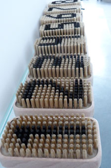 Jack Mercer's numbered barbers' brushes have bristles the excat length of the corresponding clipper gradient.
