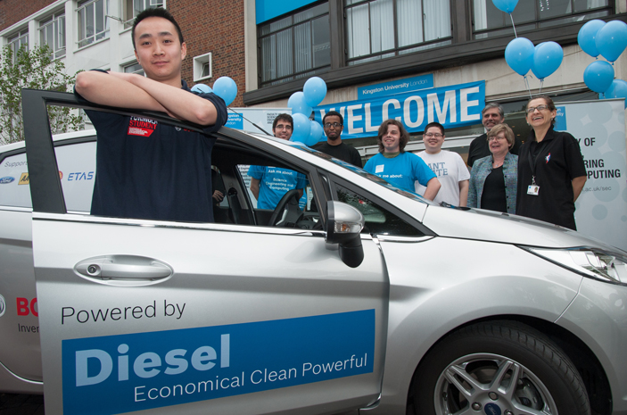 A team of staff and students cheered driver Andy Ng on his way he set off from  Kingston University's Penrhyn Road campus.