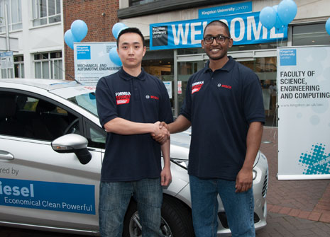 Kingston University driver Andy Ng, left, receives the keys from Brunel University team member  Jihad Noor