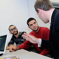 Researcher in discussion with students