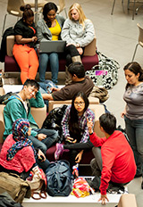 Students in the atrium of the Business School building