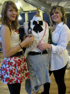 Students Laura Hemesley, left, and Clara Halsall showed a queue of fashion lovers how accessories and trimmings could transform outfits at the Queen Elizabeth's Foundation Swapping for Good event.