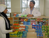 Pharmacy student Jamie Wilkinson advises class mate Roohil Yusuf on medication.
