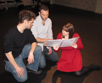 Students from the MA in Classical Theatre Matt Enos and Naomi Marsden run through their lines for As You Like It with actor David Sturzaker (centre).