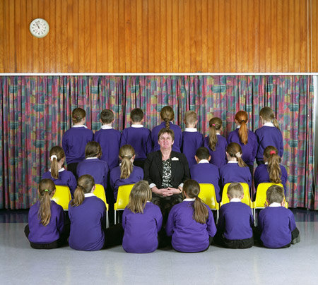 A class photo of children at Mildene Primary School - the only face visible is the teacher's.