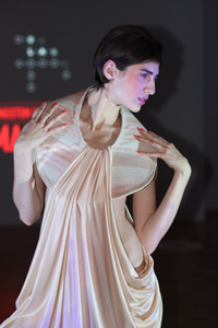 MA Fashion graduate Rachel Lamb used distinctive draping to symbolise wrinkles and the natural folds of the skin