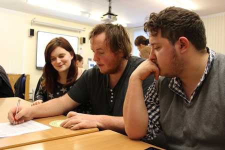 Students Josie Murray, Alistair Smith and Alastair Crow testing out some of their teaching materials.