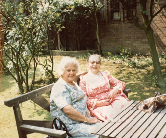 Sculptor Dora Gordine, right, relaxes with a friend in the garden she loved.