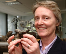 Dr Angela Milner, from London's Natural History Museum, holds a miniature skeleton replica of Baryonyx. In her interviews she recalls how she discovered the dinosaur.