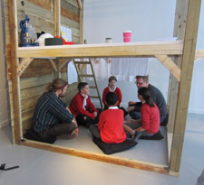 Children planning how to construct their clubhouse with Jim Robertson and Harry Laskowski.