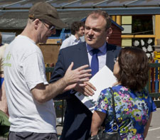 Senior research fellow Dr Kevin Burchell, left, and Professor Ruth Rettie discuss the Smart Communities project with MP Ed Davey.