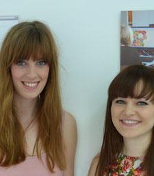 Rachel Mintern, left, and Sophie Burt with the branding for their award-winning Mid Way idea.