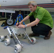 Dr Adam Baker with a Mars rover prototype developed at Kingston University.