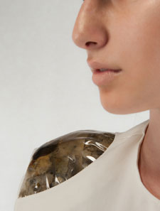 A shoulder pad designed by Ninela Ivanova – complete with mould growing inside the PVC.